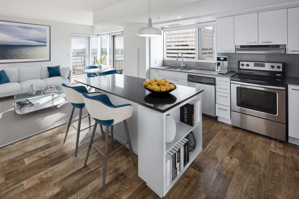 Kitchen with white cabinetry and stainless-steel appliances at 19Twenty Apartments in Halifax, Nova Scotia
