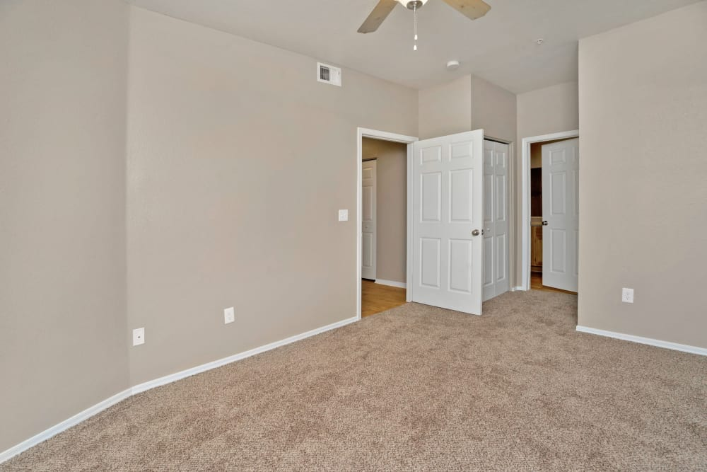 Bedroom with a ceiling fan at Ventana Canyon Apartments in Albuquerque, NM