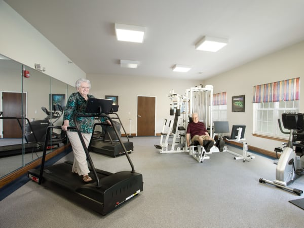 Residents exercising in the fitness center at Randall Residence of Decatur in Decatur, Illinois