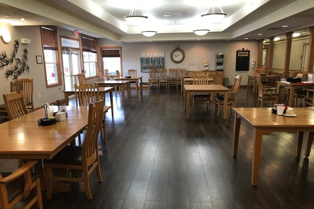 Spacious and brightly lit dining room at Prairie Hills Des Moines in Des Moines, Iowa.
