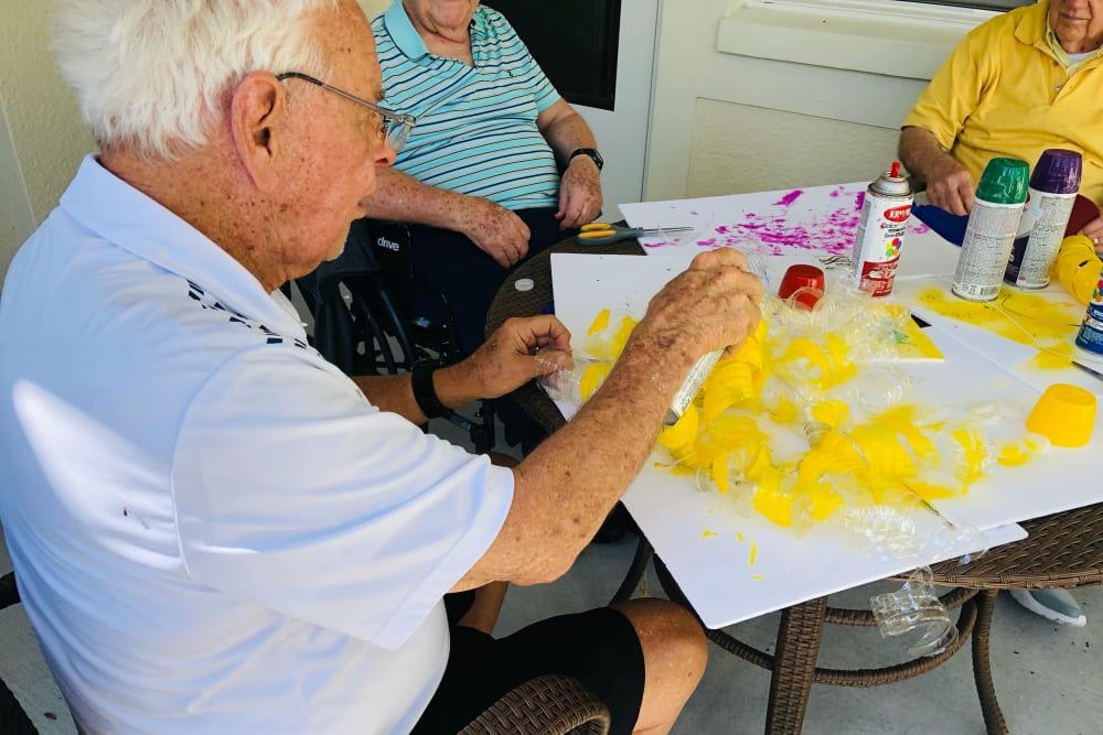Residents making art projects at CERTUS Premier Memory Care Living in Orange City, Florida.