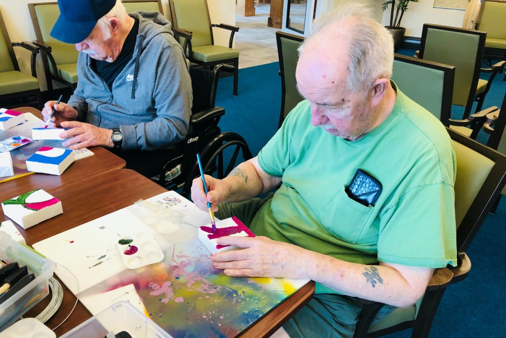 Residents painting at CERTUS Premier Memory Care Living in Orange City, Florida.