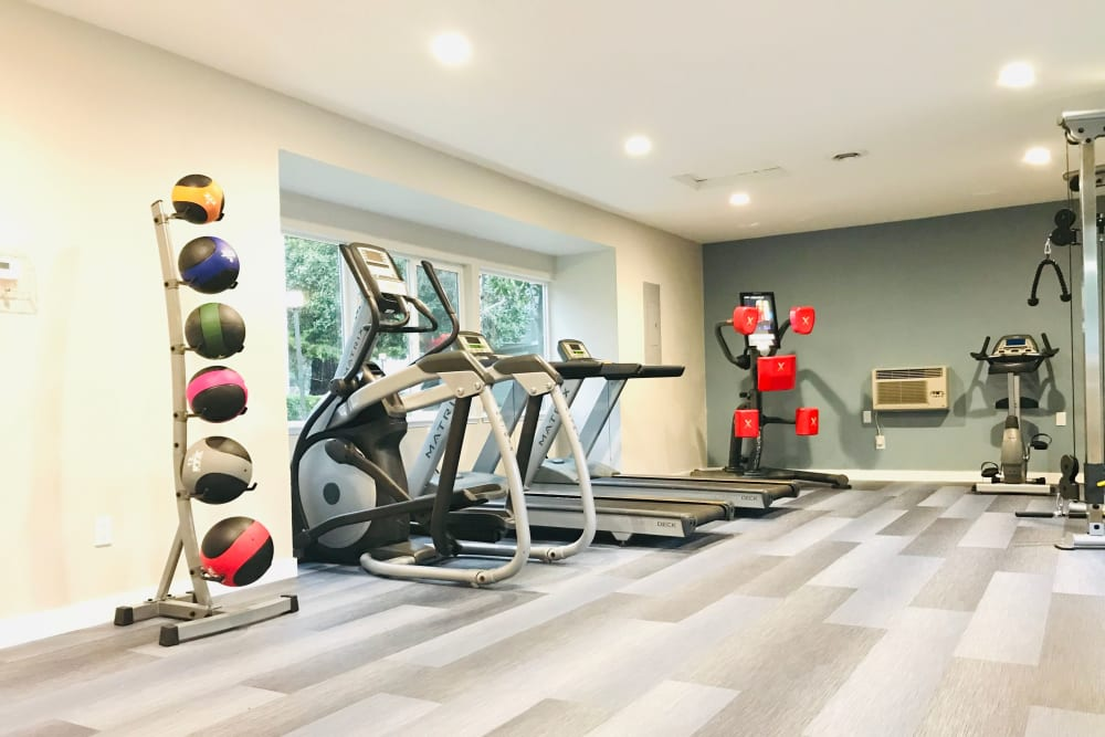 A fully equipped fitness center with weight and cardio machines at Bennington Apartments in Fairfield, California