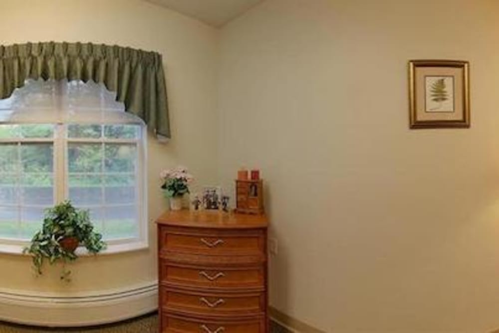 Resident studio apartment with large windows at Milestone Senior Living in Rhinelander, Wisconsin.