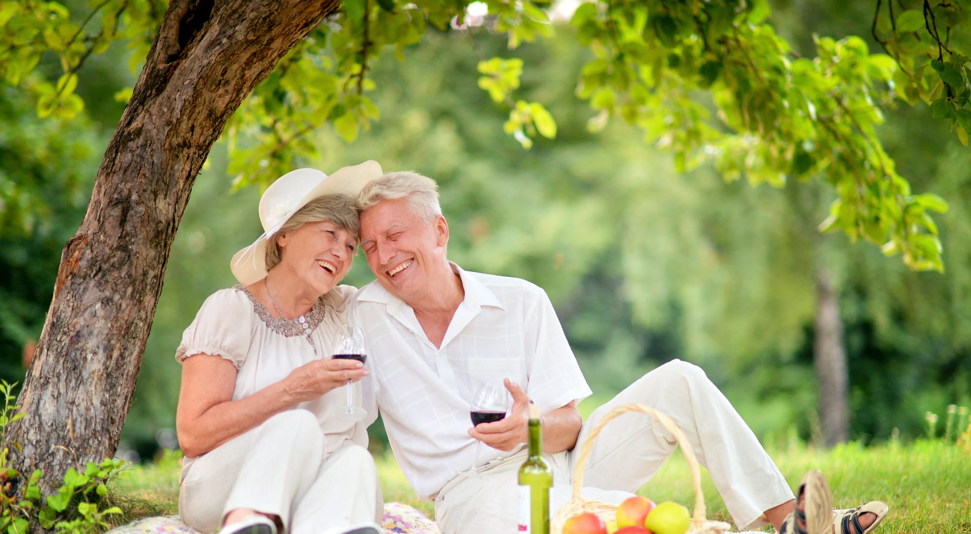 Resident couple enjoying a picnic near Pear Valley Senior Living