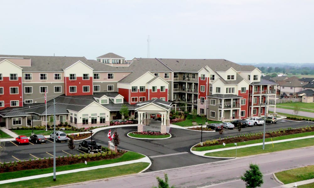 Building exterior and main entrance of Cedarview Gracious Retirement Living in Woodstock, Ontario