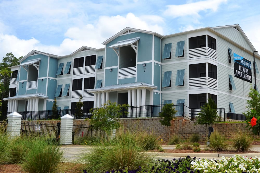 Exterior and walkway at West Woods Apartments in Pensacola, Florida
