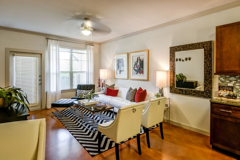 Open living room with hardwood floors at Firewheel Apartments in San Antonio