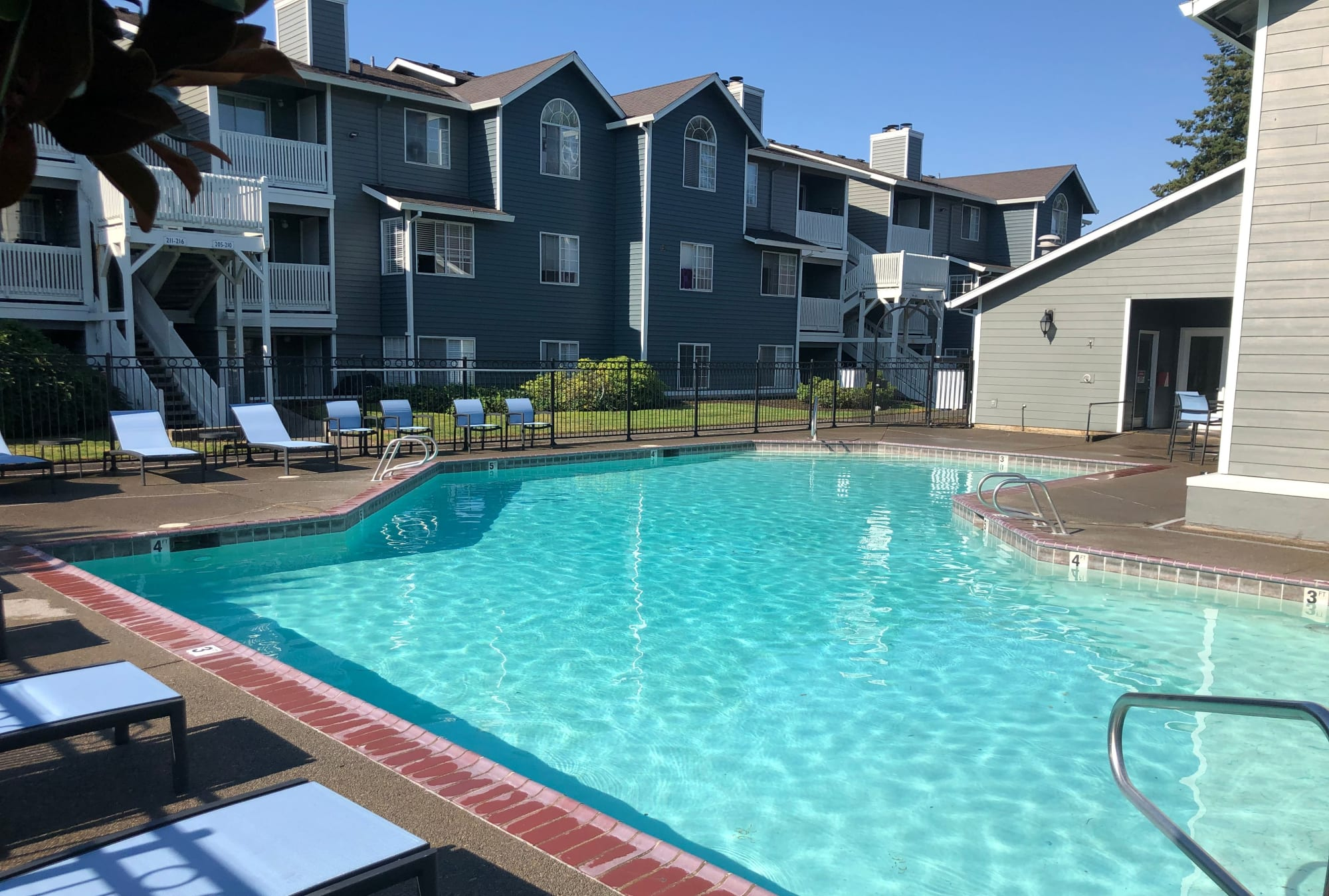 Beautiful pool area and lounge chairs at Walnut Grove Landing Apartments in Vancouver, WA