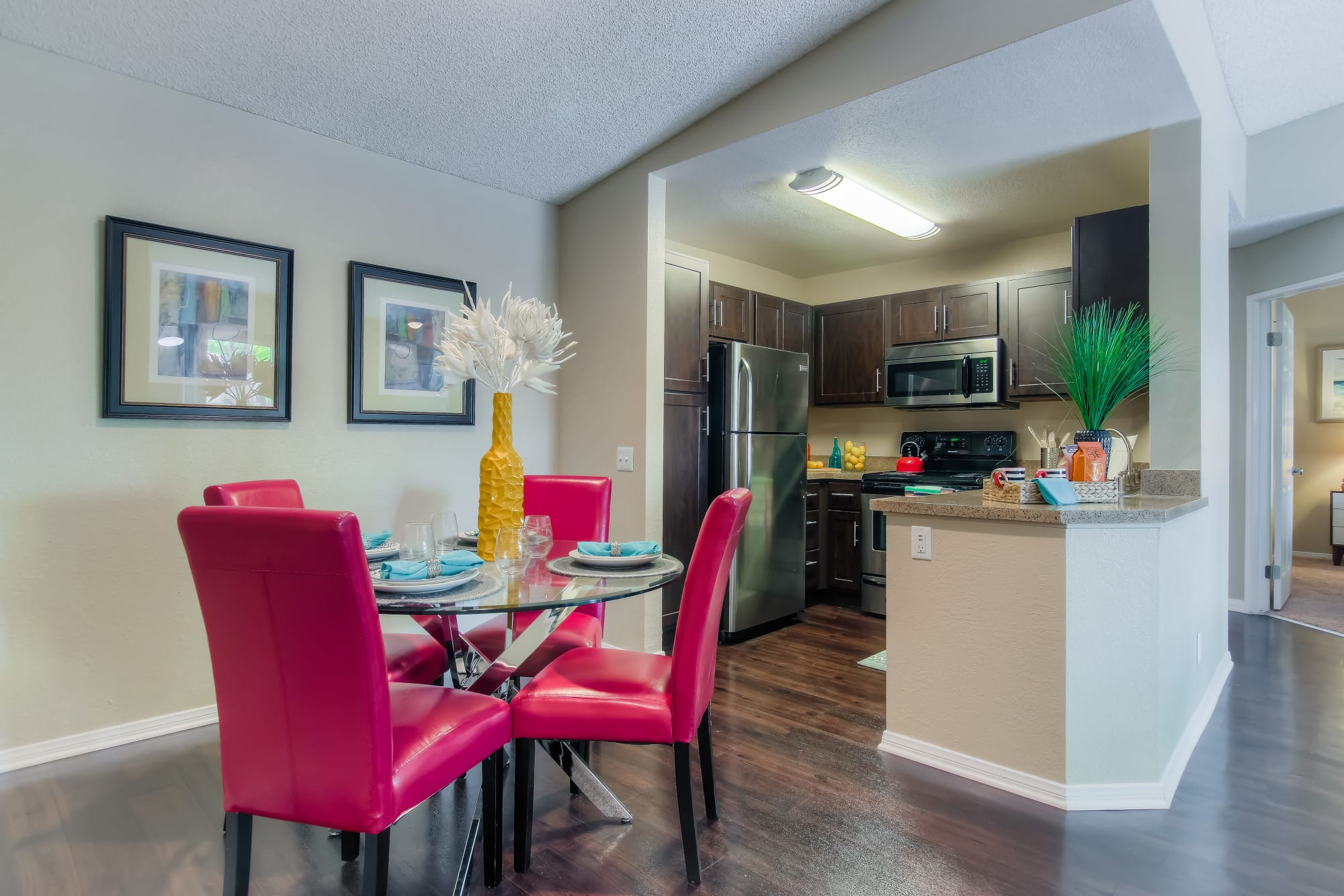 Dining room and kitchen view At Tuscany Village Apartments