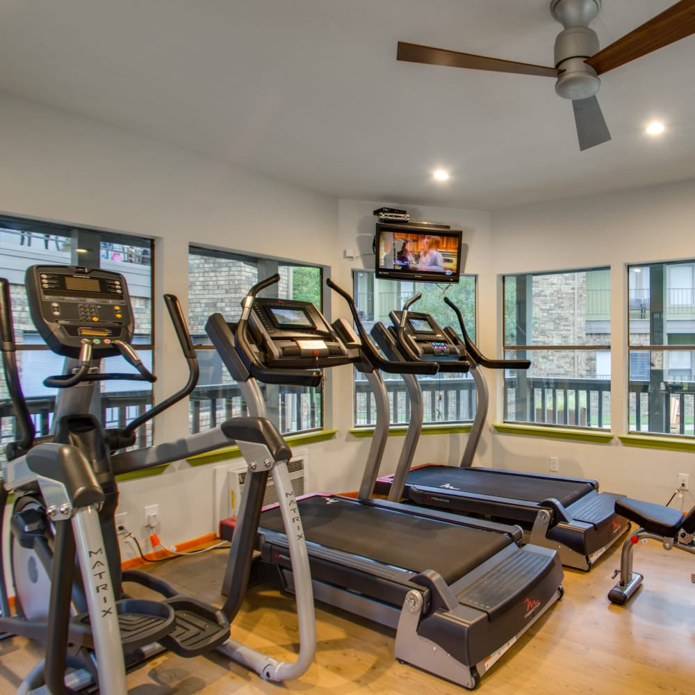 Equipment in the fitness center at Watermarke Apartments in Fort Worth, Texas
