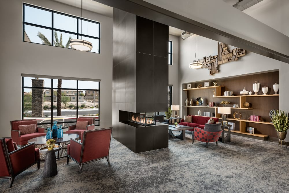 Lounge area around fireplace at Carnegie Heights at Henderson in Henderson, Nevada