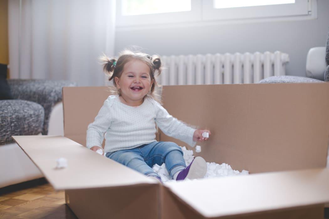 Baby playing in a box from Lockaway Storage in Texarkana, Texas