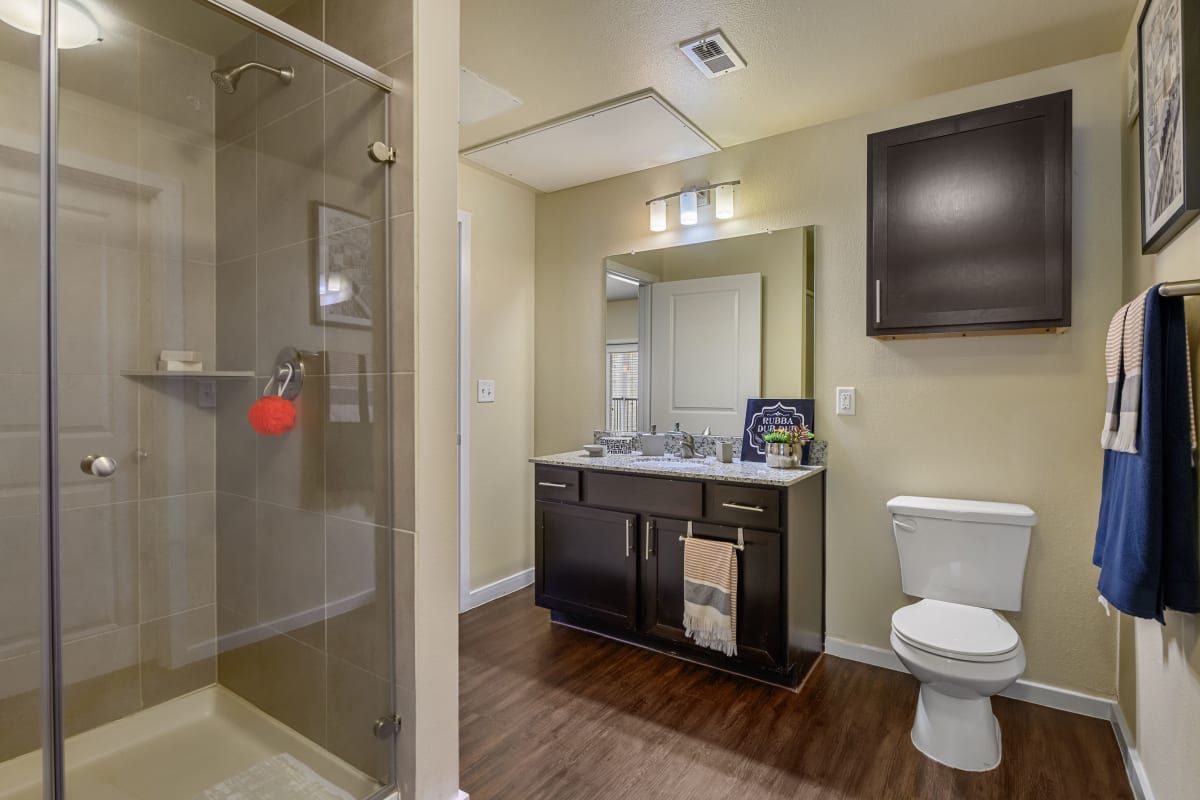 Modern bathroom with a glass shower at Marquis SoCo in Austin, Texas