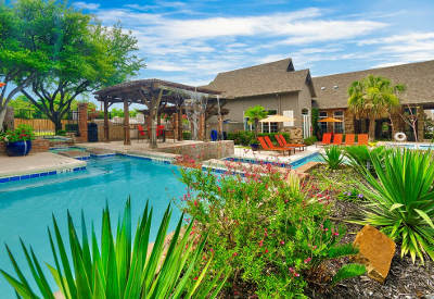 Sparkling swimming pool at Village Green of Bear Creek in Euless, Texas