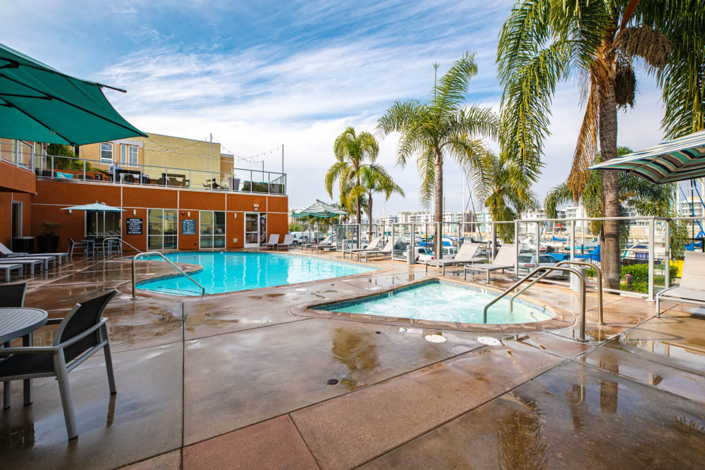 Enjoy relaxing poolside at Harborside Marina Bay Apartments in Marina del Rey, California
