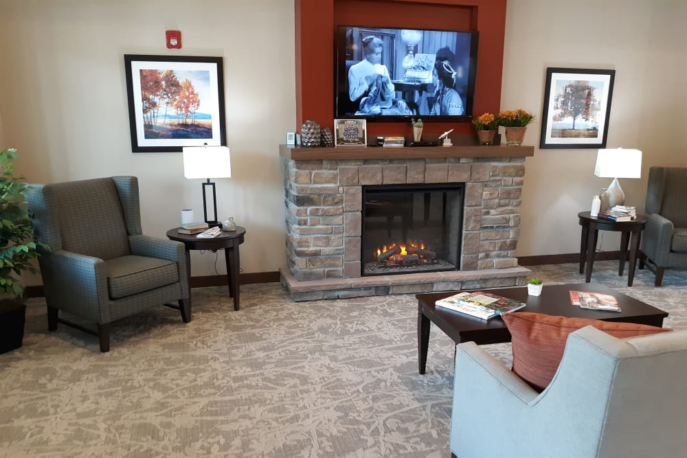 Living room with fireplace at Country Meadow Place in Mason City, Iowa