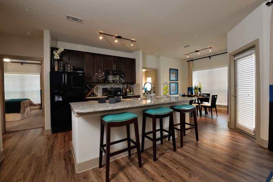 Kitchen with breakfast bar at Cordevalle Apartments in Round Rock, Texas