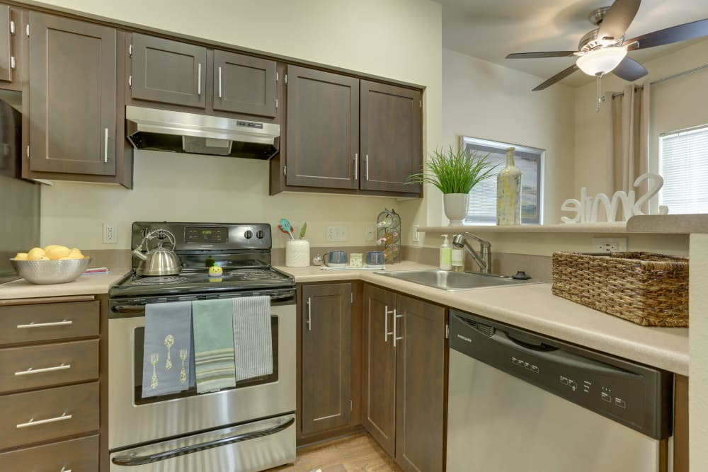Kitchen with espresso cabinets at The Landings at Morrison Apartments in Gresham, Oregon