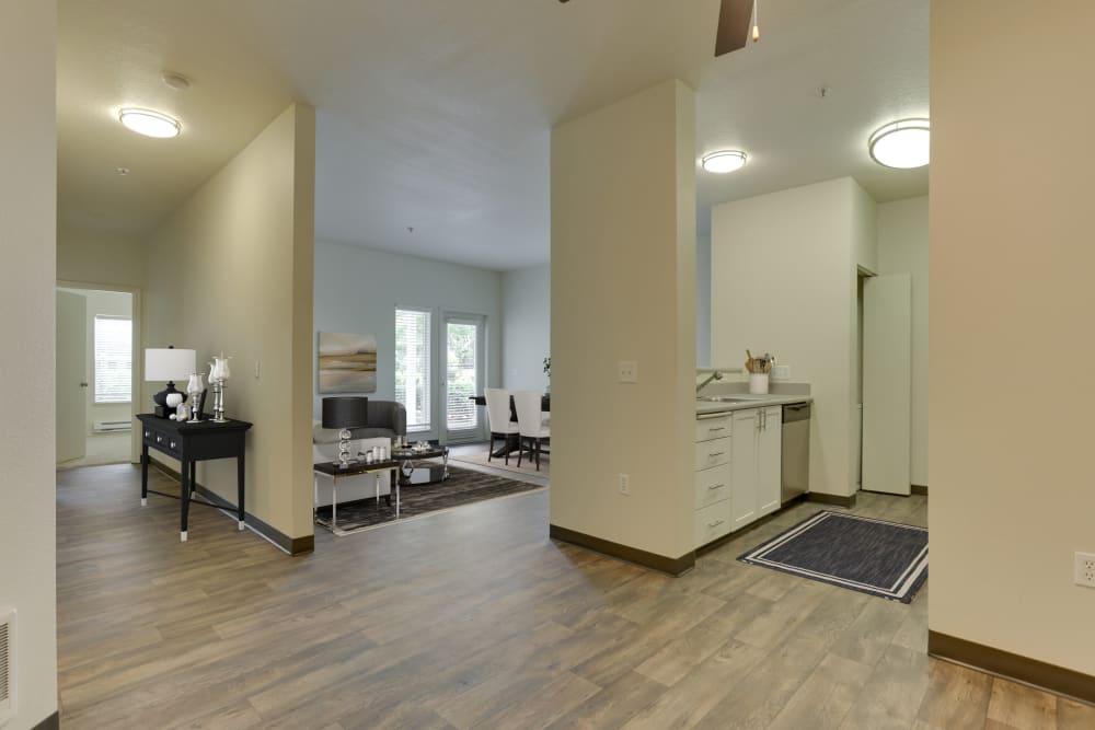 Entryway with wood-style flooring at The Landings at Morrison Apartments in Gresham, Oregon