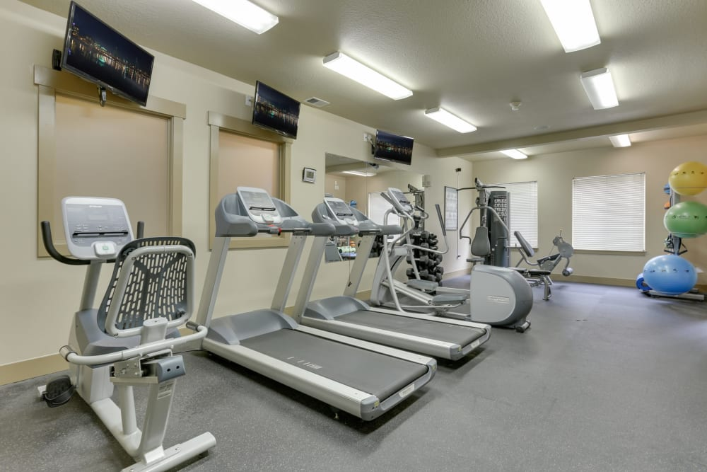 Fitness center with plenty of individual workout stations at The Landings at Morrison Apartments in Gresham, Oregon