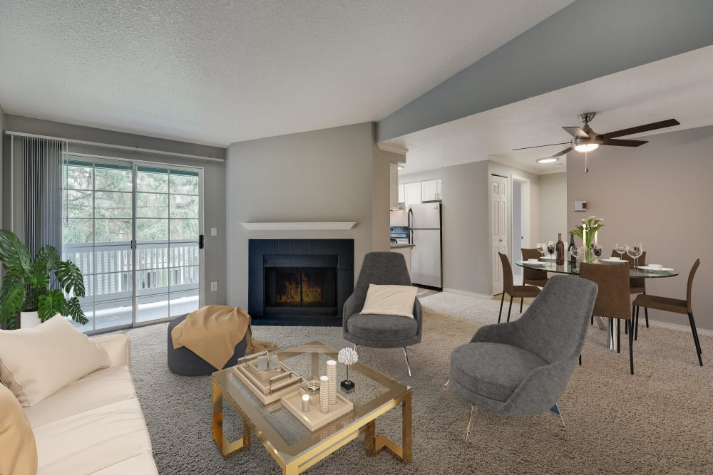 Spacious living room with a fireplace at Walnut Grove Landing Apartments in Vancouver, Washington