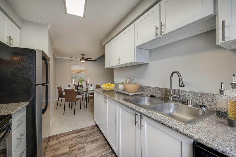 A kitchen with plenty of cabinet space at Walnut Grove Landing Apartments in Vancouver, Washington