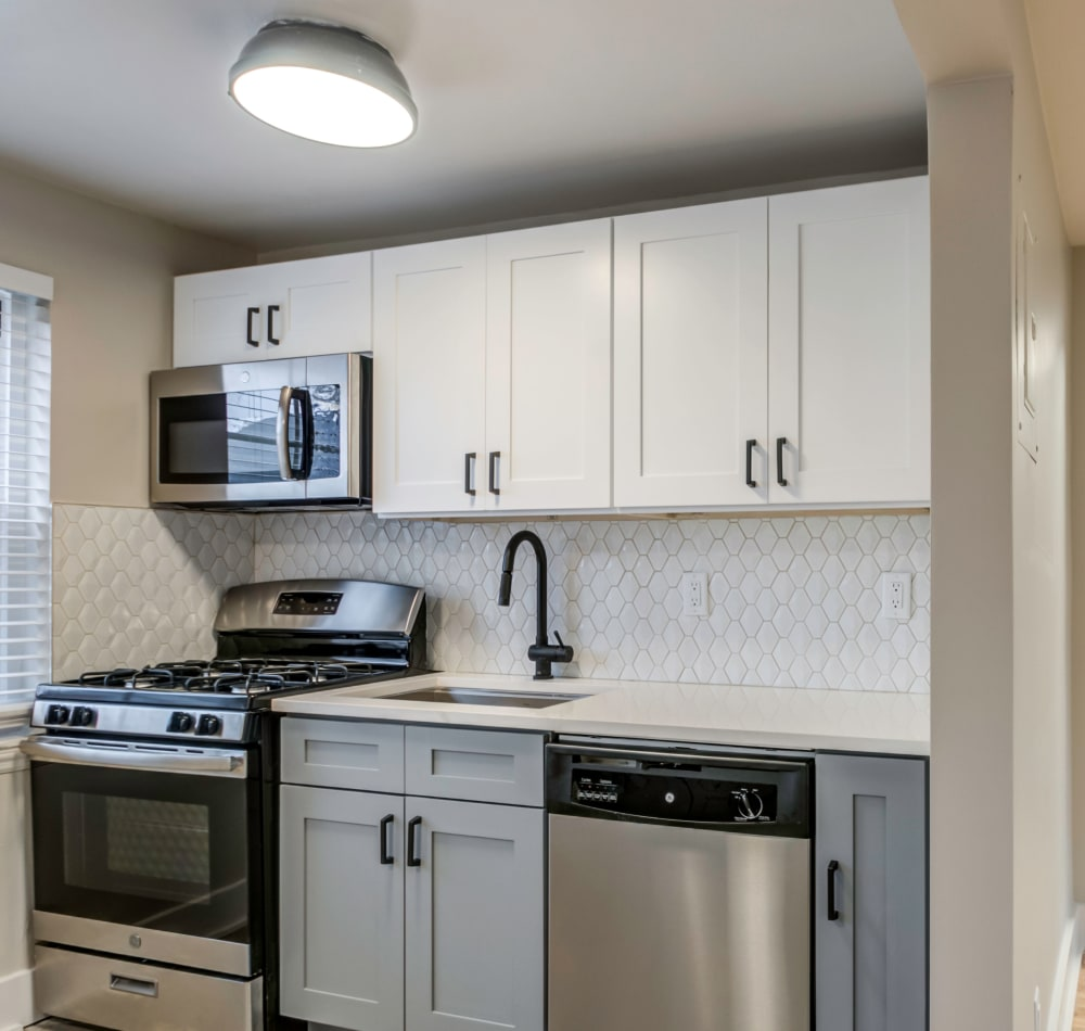 Kitchen with a stainless steel sink at Haven New Providence in New Providence, New Jersey