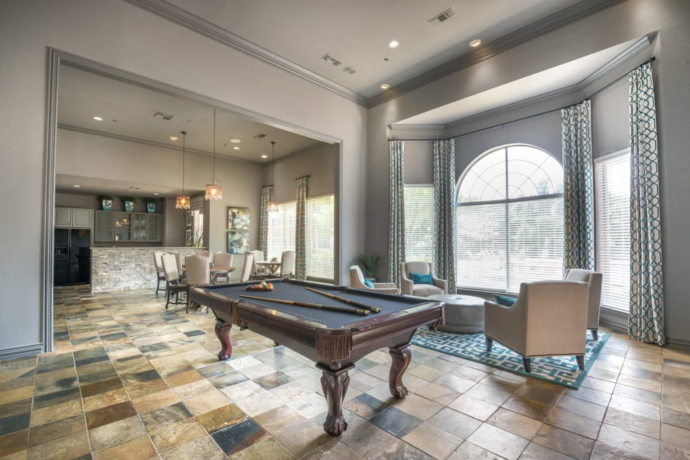 Game room with a billiards table and more in the resident clubhouse at 23Hundred @ Ridgeview in Plano, Texas