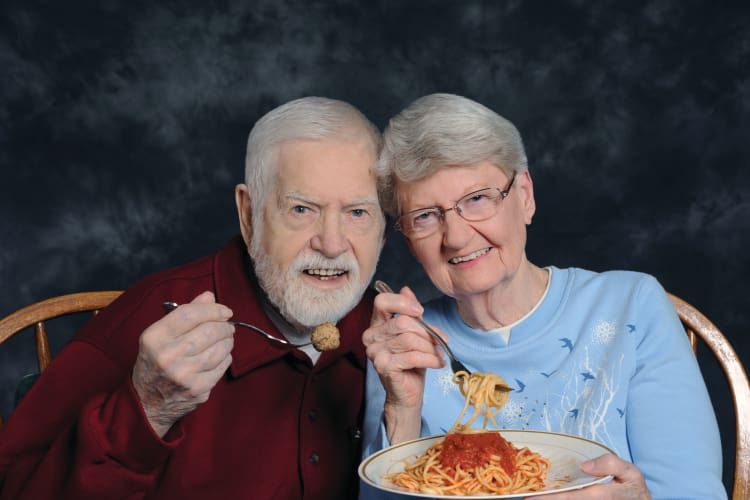 Elderly couple having dinner at Arbour Square of Harleysville