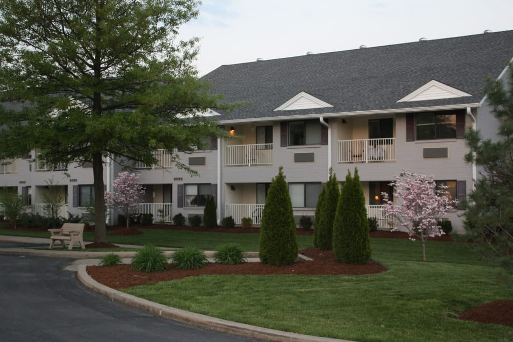 Exterior view of resident apartment buildings and lush landscaping at Willow Creek Senior Living in Elizabethtown, Kentucky.