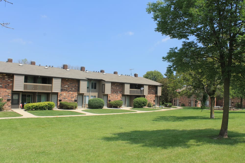 Apartments with beautiful landscaping at American Colony Apartments