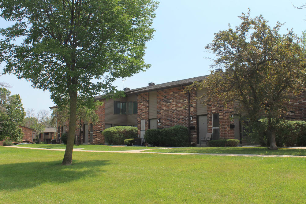 Apartments with beautiful landscaping at American Colony Apartments, in Greenfield , WI