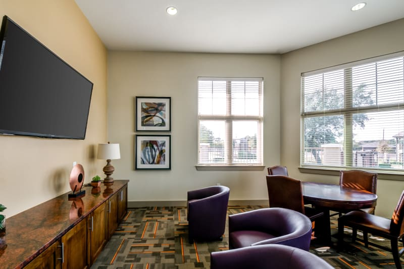 Lobby area with TV at Firewheel Apartments in San Antonio