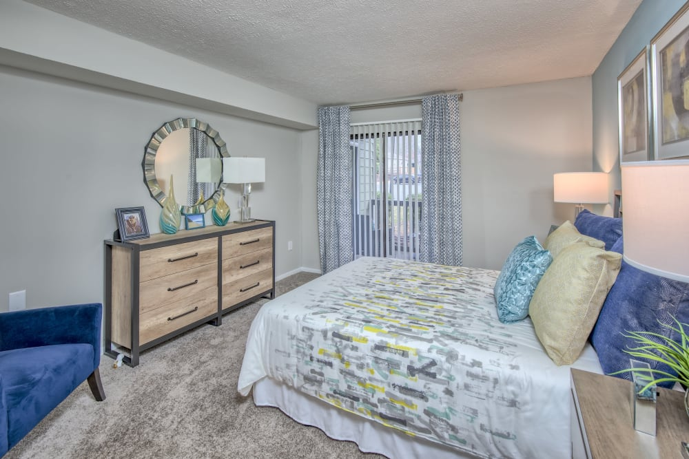 Well lit model bedroom with large window at The Madison in Charlotte, North Carolina