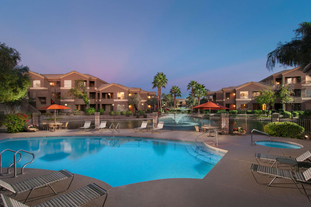 Beautiful swimming pool at dusk at Laguna at Arrowhead Ranch in Glendale, Arizona