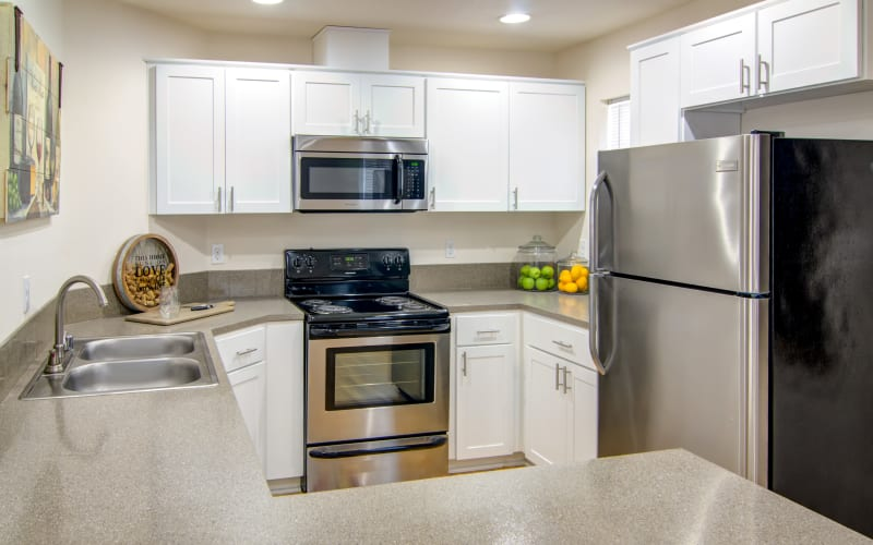 Renovated kitchen with white cabinets at The Addison Apartments in Vancouver, Washington