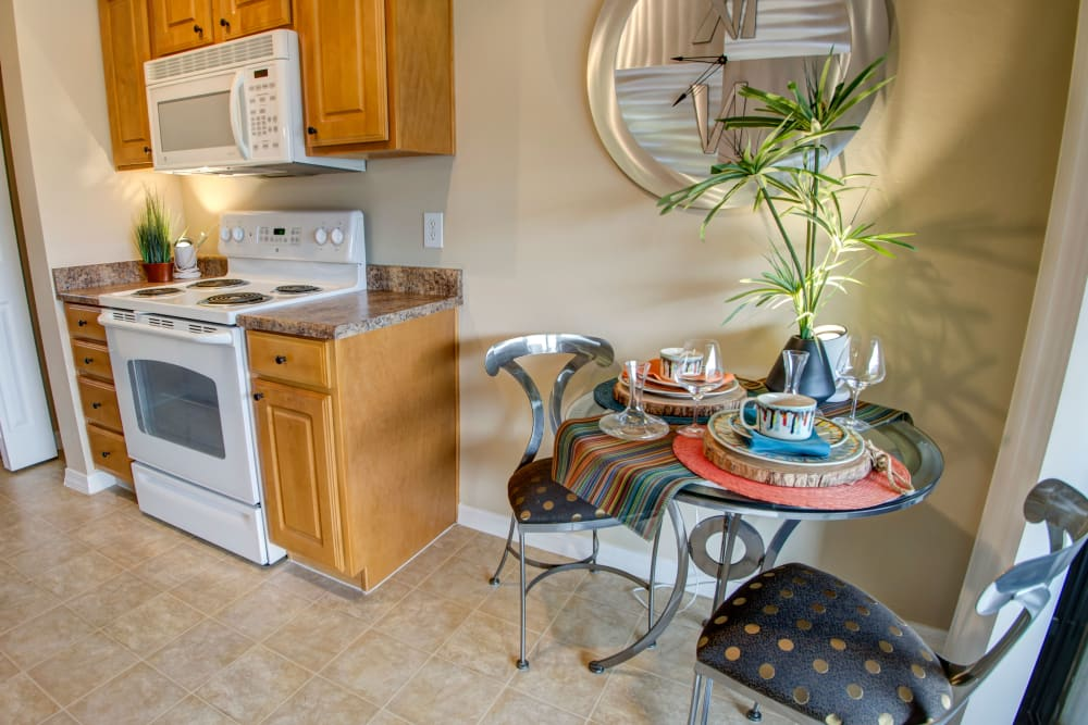 Model kitchen and dining area at Oro Vista Apartments in Oro Valley, Arizona