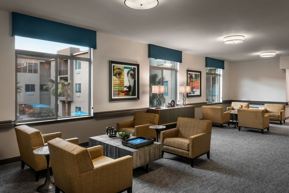 Lounge near window at Carnegie Heights at Henderson in Henderson, Nevada