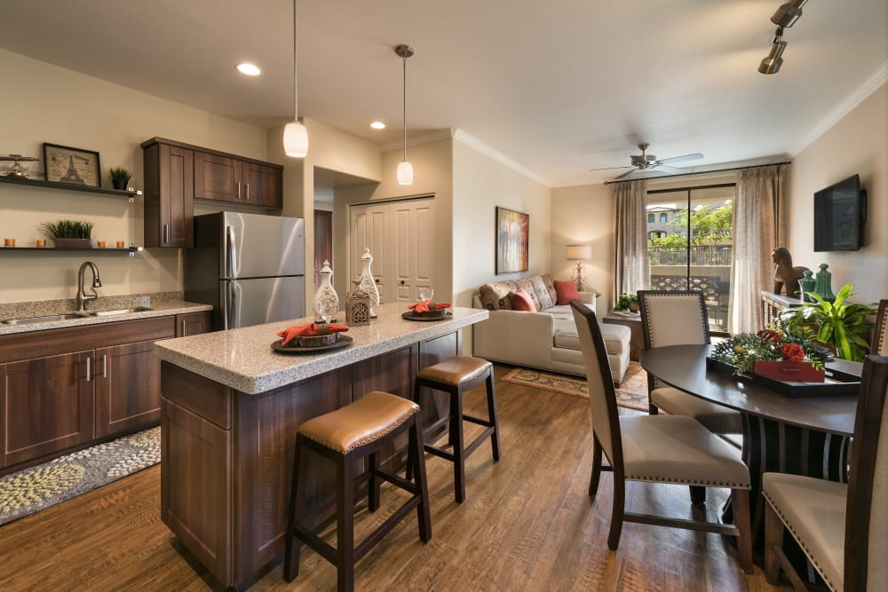 Gourmet kitchen with granite countertops in model home at San Sonoma in Tempe, Arizona