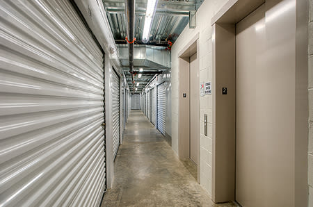 Well lit hallways at StorQuest Self Storage in Tigard, Oregon