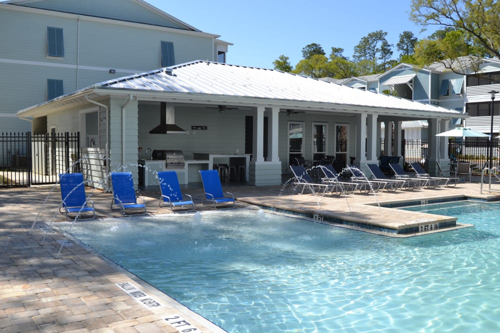 The community pool at West Woods Apartments in Pensacola, Florida