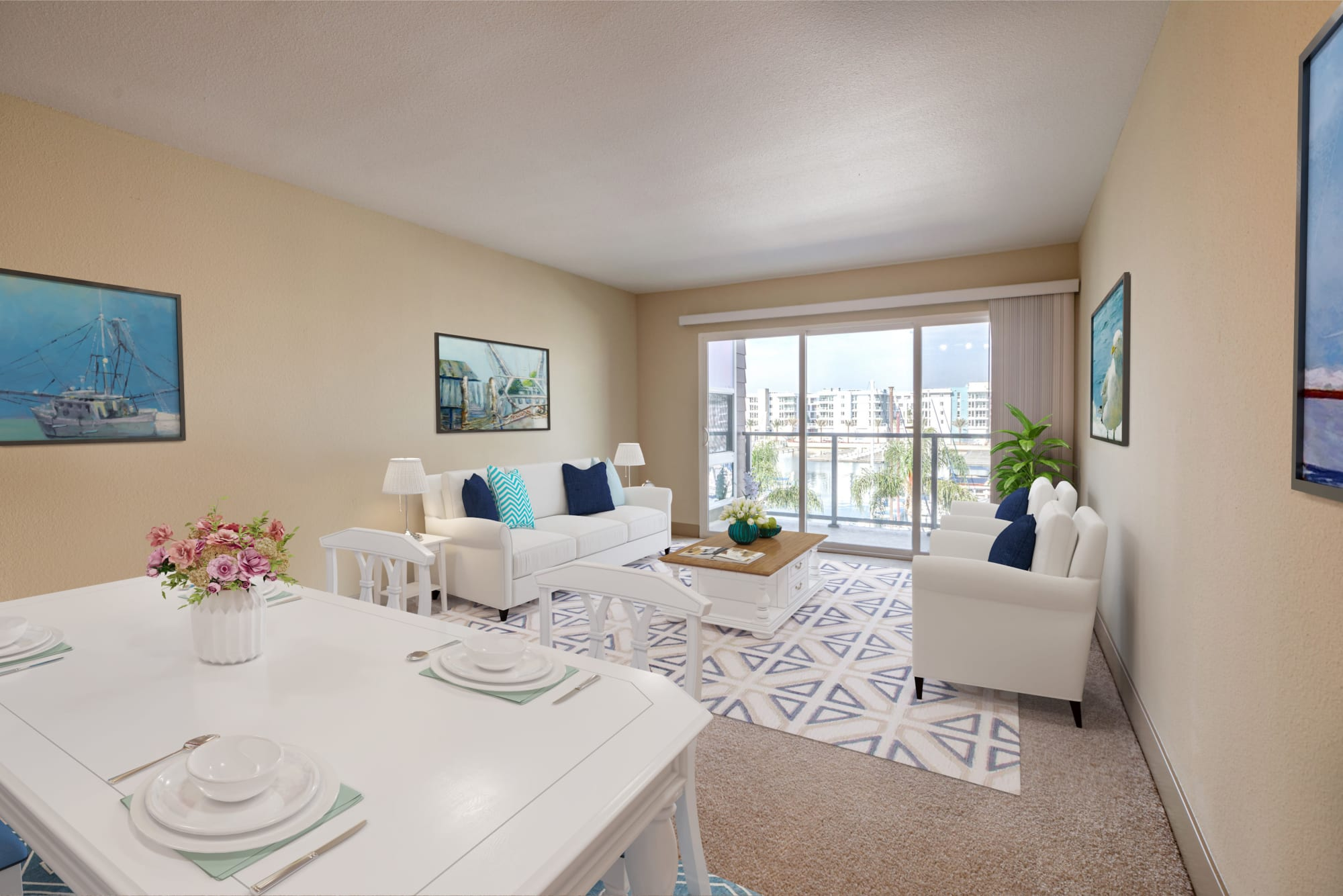 Daylight pours through floor-to-ceiling windows into the living room at Harborside Marina Bay Apartments in Marina del Rey, California