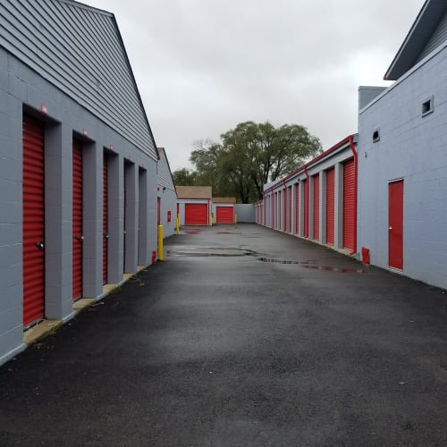 Outdoor storage units with red doors at Red Dot Storage in North Aurora, Illinois