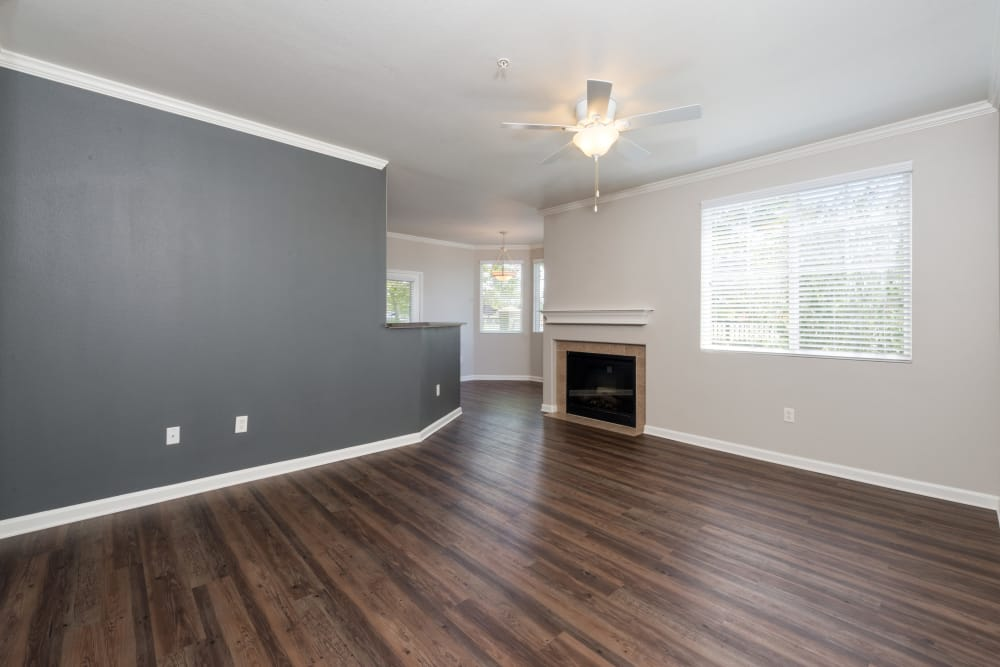 Spacious floor plan featuring distressed faux-hardwood flooring at The Artisan Apartment Homes in Sacramento, California