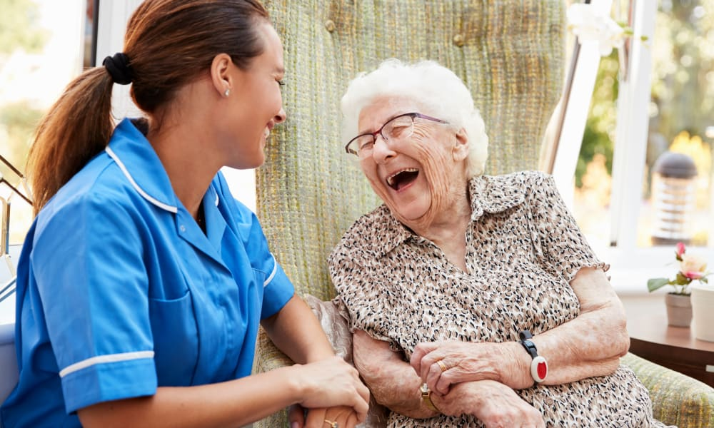 Resident sitting and talking to a nurse at Randall Residence of Centerville in Centerville, Ohio