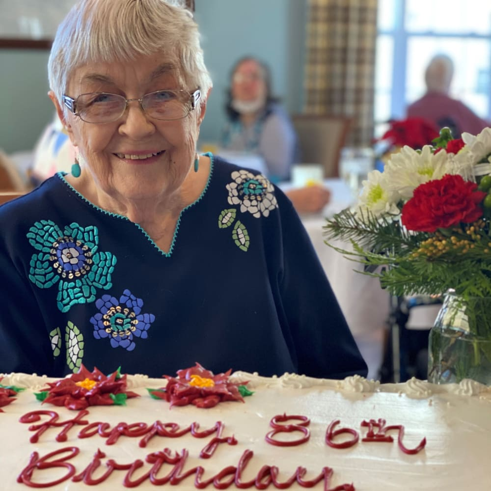 Resident and birthday cake at Glenwood Place in Marshalltown, Iowa.