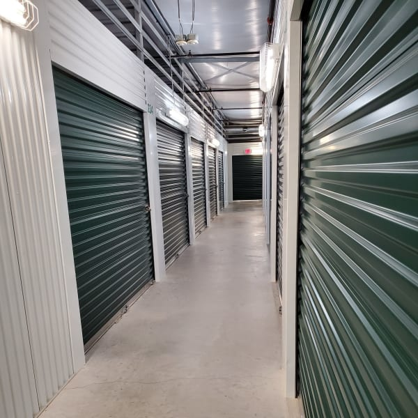 Indoor storage units with green doors at StorQuest Self Storage in Tallahassee, Florida