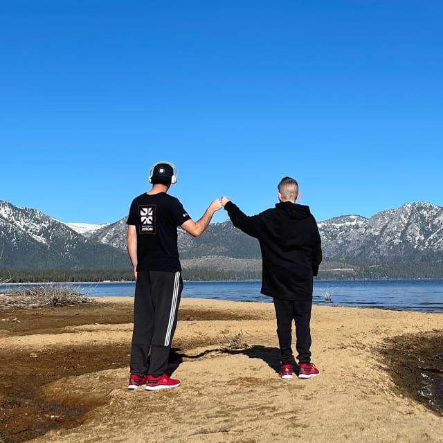 2 people overlooking lake