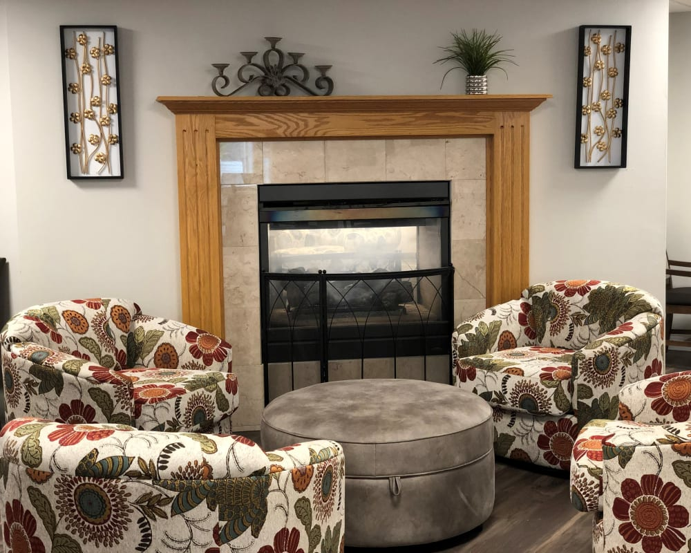 Community space for residents with fireplace and comfortable furniture at Corridor Crossing Place in Cedar Rapids, Iowa.